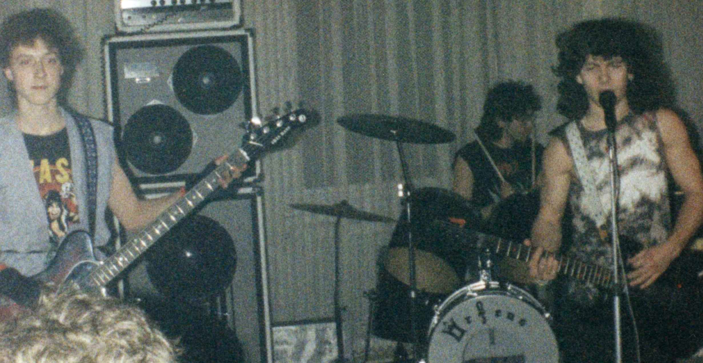 I sing and play on the guitar in the Decretum band. I am on the right side on the picture. In 1990.